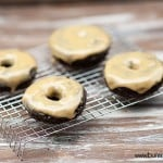 A donut with peanut butter icing on a cooling wire rack.