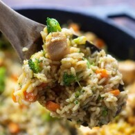 Healthy one dish dinner!! Cheesy chicken and rice with broccoli and carrots is always a family favorite and it's ready in about 30 minutes. #recipe #chicken #cheesy #rice #healthy