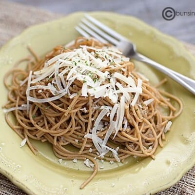 A plate of brown butter pasta topped with shredded cheese