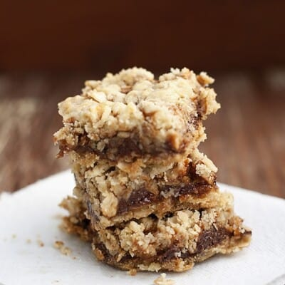 A stack of oatmeal bars on a square white plate.