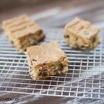A few squares of peanut butter snack cakes on a cooling rack.