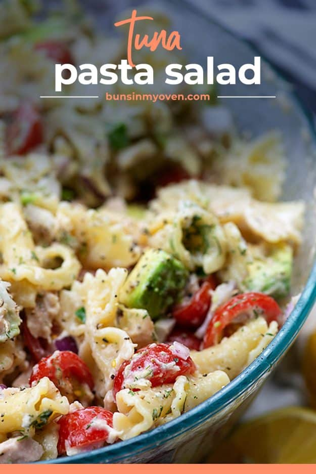 pasta salad with tuna and avocado in glass bowl.