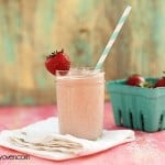 A strawberry milkshake in a glass jar
