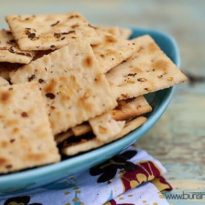 The pile of season saltines io an appetizer plate