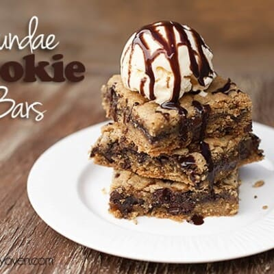 A stack of cookie bars with a scoop of ice cream on top