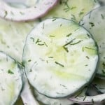 Creamy cucumber and onion salad! This cold salad makes a great summer side dish. #sidedish #summer #cucumbersalad