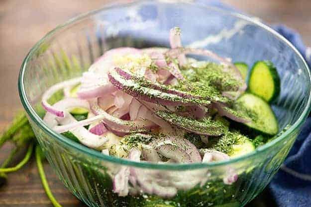 cucumber salad ingredients in glass bowl