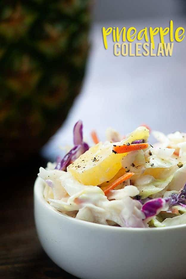 Pineapple coleslaw is the perfect summer side! Use it top your pulled pork sandwiches or just eat it on it's own! #recipe