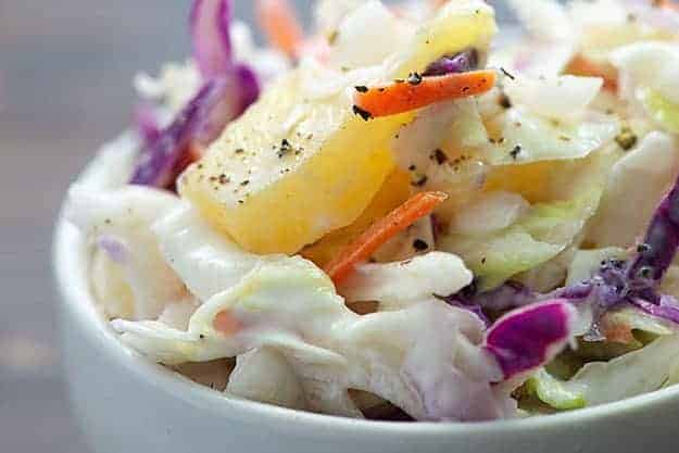 pineapple coleslaw in white bowl