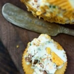 Ritz cracker topped with bacon cheese spread.