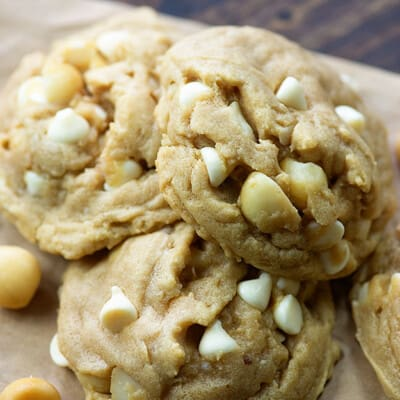 A close up of stacked macadamia nut cookies.