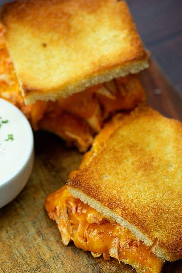 Buffalo Chicken Grilled Cheese in the oven!! This grilled cheese recipe feeds a crowd and is the perfect football food! #buffalochicken #football #superbowl #snacks #recipe