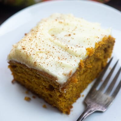 A piece of carrot cake with cream cheese frosting.
