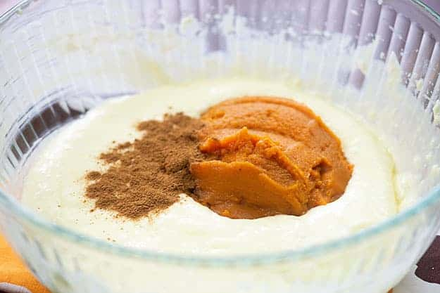 pumpkin cheesecake batter in glass bowl