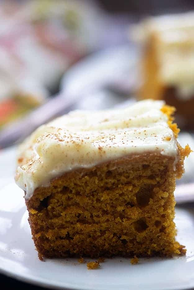 A square piece of carrot cake.