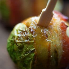 Bacon wrapped Brussels sprouts topped off with maple syrup and a little cayenne pepper! Such an elegant appetizer for the holidays! #recipe #appetizer #holidays #christmas