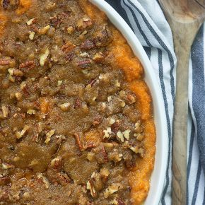 The BEST sweet potato casserole ever!! We make this every holiday - that crunchy pecan topping is perfection and this recipe is really easy. #holidays #easy #sidedish #recipe