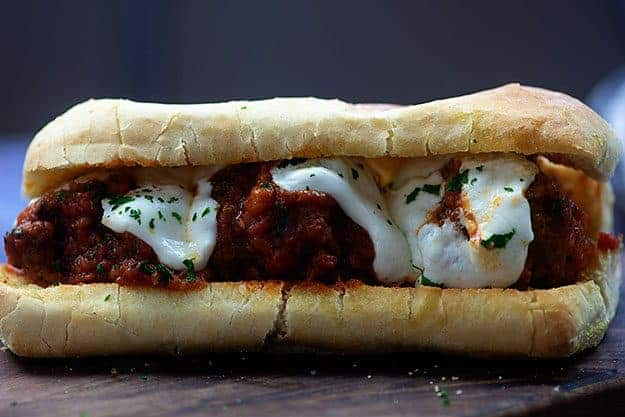 meatball sub on wooden cutting board