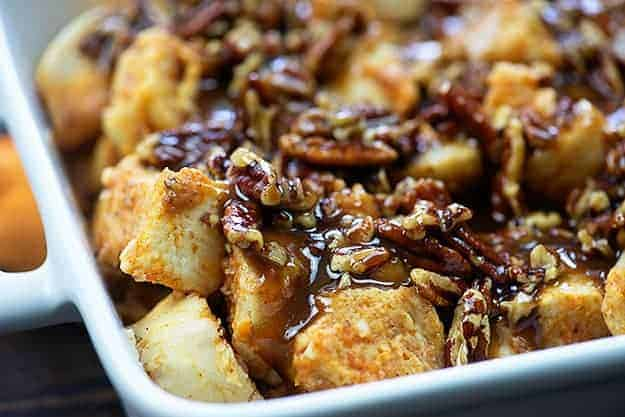 praline topping on french toast casserole in white baking dish