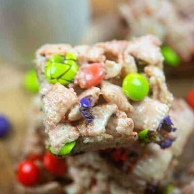 Stacked square cereal bars with m&m's.