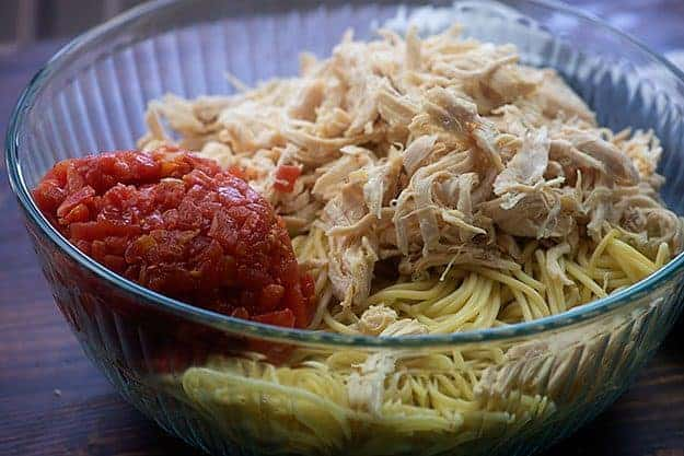 ingredients for chicken spaghetti in glass bowl