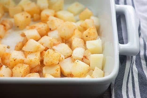 seasoned potatoes in baking dish