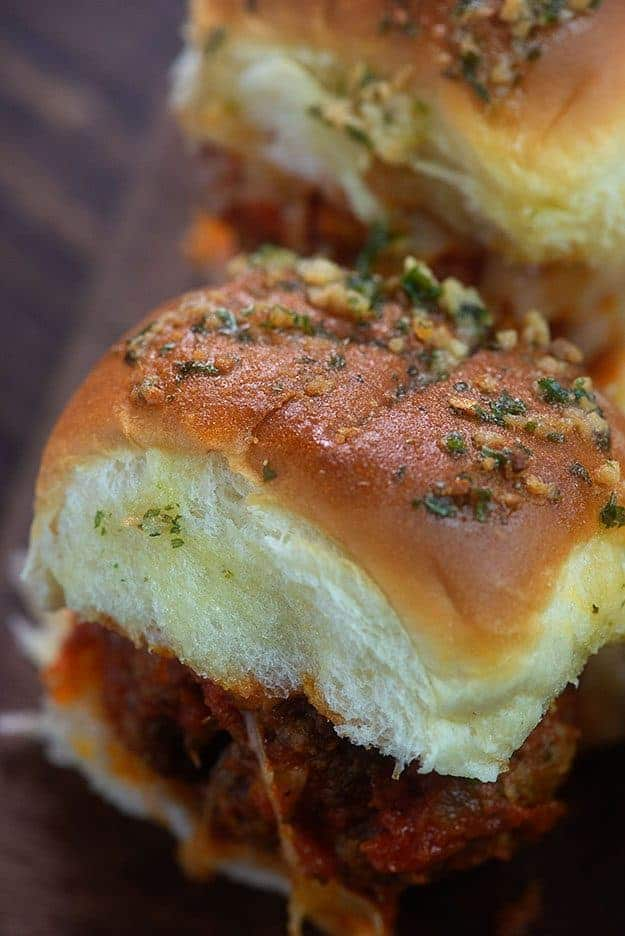 A close up of a meatball slider.
