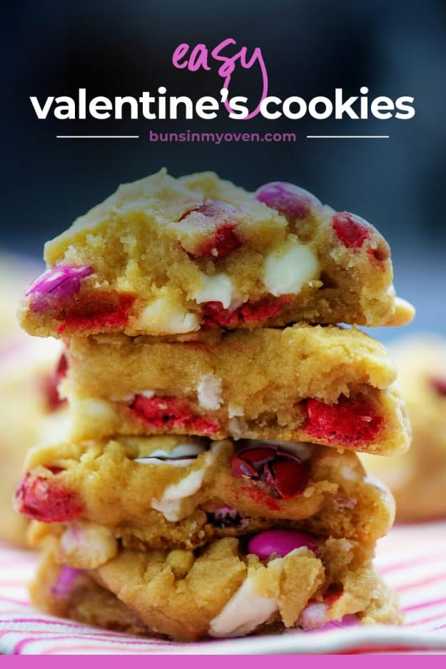 stack of Valentine's Day cookies on striped napkin.