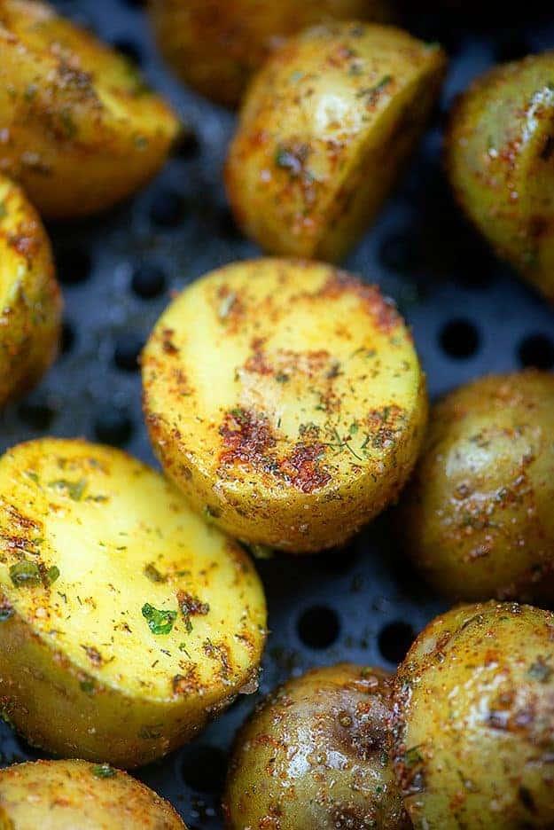 seasoned potatoes in air fryer basket