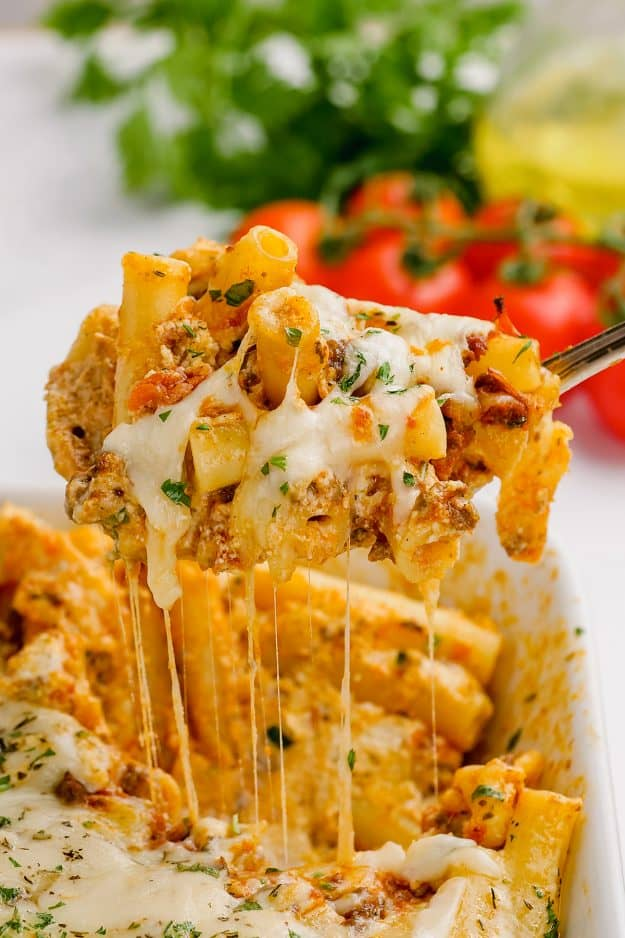 cheesy baked ziti in dish.