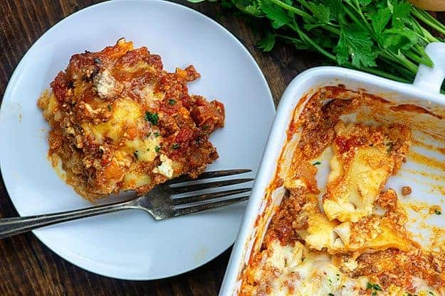 cheesy lasagna recipe on white plate