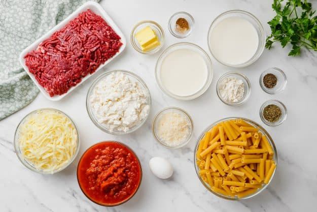 ingredients for baked ziti on white counter.