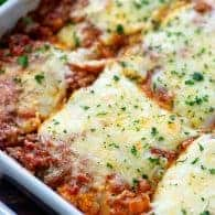 Skip the lasagna noodles - cheese ravioli is PERFECT for making lasagna! Extra cheesy and extra easy! #lasagna #easyrecipe #dinner