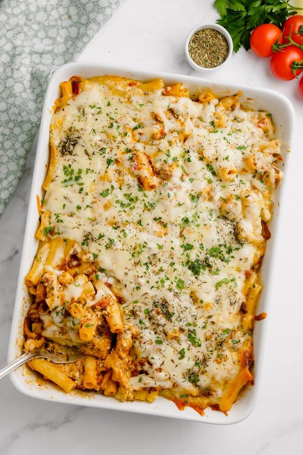 overhead view of baked ziti with meat sauce in white dish.