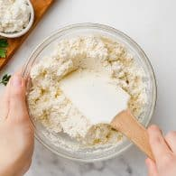 ricotta cheese in glass bowl.