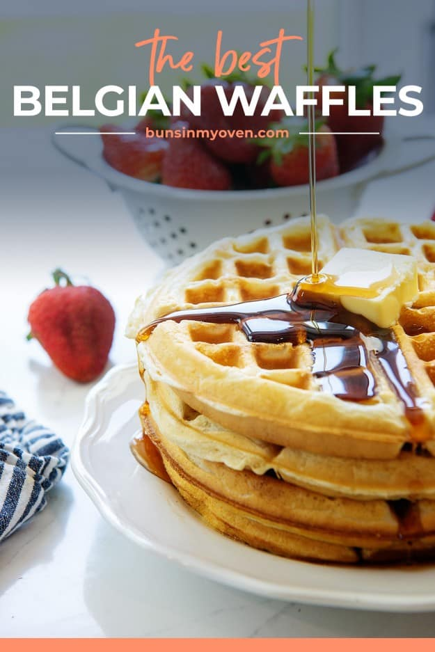 waffles with syrup being drizzled over the top.
