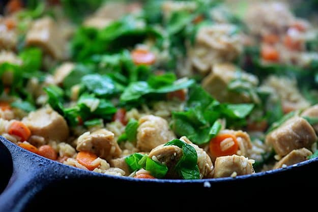 spinach with chicken and rice in skillet
