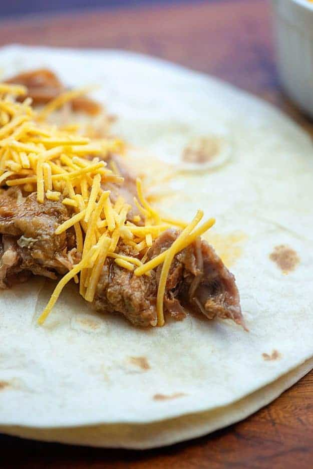 pulled pork and cheese in tortilla