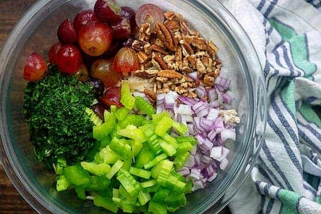 chicken salad recipe with grapes and pecans in glass bowl