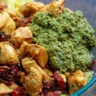 chicken with pesto in glass bowl