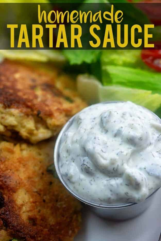 Homemade tartar sauce next to salmon patties.