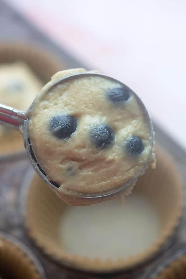 muffin batter in cookie scoop.