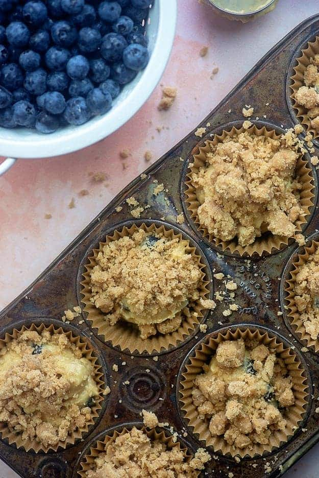 blueberry muffins with streusel in muffin tin.