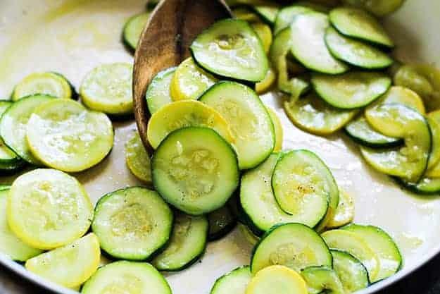 sauteed zucchini in pan.