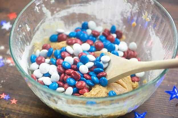 cookie dough in glass bowl with red white and blue m&m candies