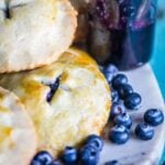 Blueberries and cookies on a cutting board