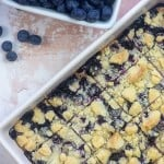 Blueberry bars cut into squares and in baking pan