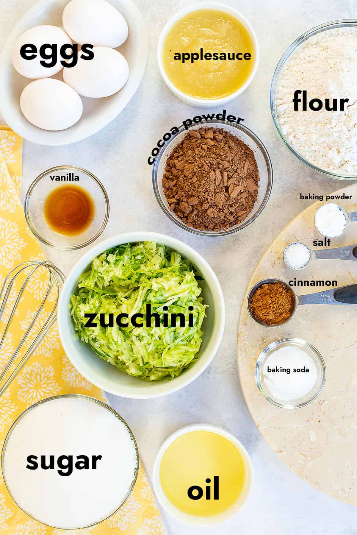 ingredients for chocolate zucchini cake on countertop.