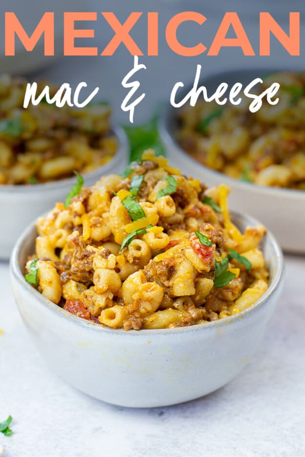 Mexican macaroni and cheese in bowl with text for Pinterest.