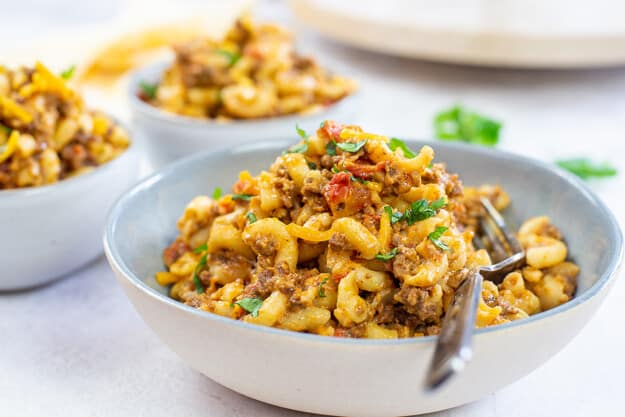 bowl piled high with mexican mac and cheese.
